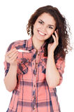 Girl with pregnancy test Royalty Free Stock Images