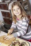 Girl prepare mushrooms. Girl with knife prepare mushrooms Stock Photography