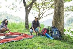 Girl prepare tent nature tourism concept. Hiker girl prepare tent nature tourism concept. Camping equipment Stock Photos