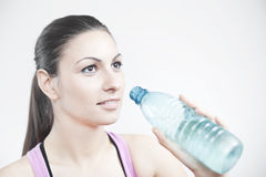 Girl prepare to drink water. Smiley and beautiful girl prepare to drink water (45 angled side view & landscape orientation Stock Photos