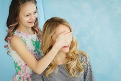 Girl prepared a surprise gift for her mother.  Royalty Free Stock Images