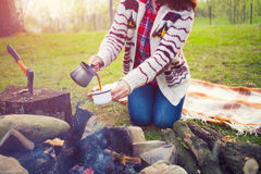The girl prepares coffee in nature. Royalty Free Stock Photo