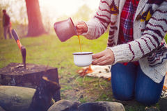 The girl prepares coffee in nature. Stock Image