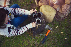 The girl prepares coffee in nature. Stock Photos