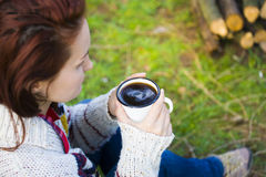 The girl prepares coffee in nature. Stock Photo