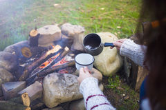 The girl prepares coffee in nature. Royalty Free Stock Photos