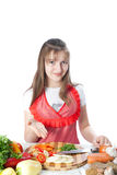 Girl prepares and offers salads Stock Photo