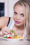 Girl prepares salad Royalty Free Stock Images