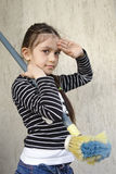 Girl prepares for sweeping. 8 years old girl prepares for sweeping royalty free stock images