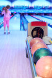 Girl prepares to throw ball in bowling Royalty Free Stock Photo