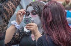 Girl prepares zombie makeup for parade. In Cuenca, Ecuador on Jan 6, 2017 stock photos