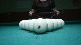The girl preparing balls for play. Girl sets billiard balls and removes plastic triangle. Billiard balls in starting stock footage