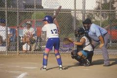 Girl preparing at bat with umpire Royalty Free Stock Photos
