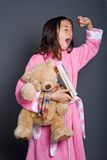 Girl preparing for bed with a book and  teddy Royalty Free Stock Photo
