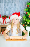 Girl preparing Christmas cookies Stock Images