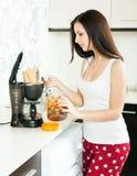 Girl preparing coffee royalty free stock photo