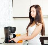 Girl preparing coffee stock images