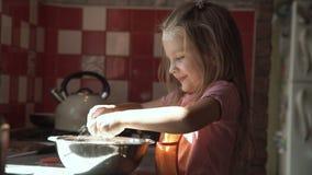 Girl preparing dough in bowl. stock video footage