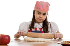 Girl preparing dough Royalty Free Stock Photo