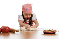 Girl preparing dough Stock Photos