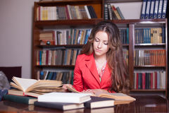 Girl is preparing for the exam in the library stock image