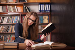 Girl is preparing for the exam reads books Royalty Free Stock Images