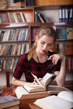 Girl is preparing for the exam reads books Stock Photography