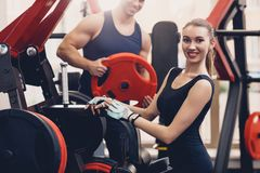 Girl is preparing the exercise training apparatus stock photography