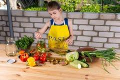 Girl Preparing Fresh Vegetables for Preserving Stock Images