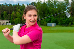 Girl is preparing for the game of golf Stock Photos