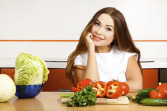 Girl preparing salad in the kitchen. Stock Image