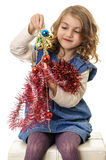 Girl preparing shiny Christmas decorations Royalty Free Stock Images