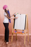 Girl preparing to paint a new masterpiece Stock Photos