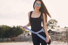 Girl preparing to ride a horse royalty free stock photos