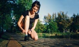 The girl is preparing to run. Stock Photo