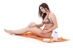 Girl preparing to take hours of sunbathing stock image
