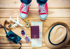 Girl preparing to travel. on wood. Girl preparing to travel. on wood Royalty Free Stock Photo