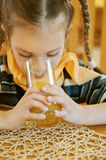Girl-preschooler drinking orange Royalty Free Stock Image