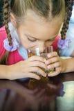 Girl-preschooler drinking orange juice Stock Photo