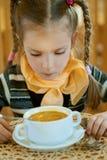 Girl-preschooler eats a tasty meal Stock Photography