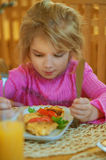 Girl-preschooler eats a tasty meal Royalty Free Stock Photography