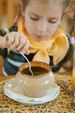 Girl-preschooler eats a tasty meal Royalty Free Stock Image