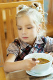 Girl-preschooler eats a tasty meal Stock Photos
