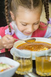 Girl-preschooler eats a tasty meal Royalty Free Stock Photos