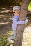 Girl-preschooler hands clasped tree Stock Photography