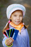 Girl-preschooler keeps bank credit Royalty Free Stock Photo
