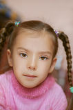 Girl-preschooler in pink sweater. Close-up Royalty Free Stock Images