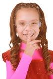 Girl-preschooler put finger to lips Stock Photos