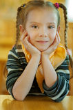 Girl-preschooler sitting at table Royalty Free Stock Photo