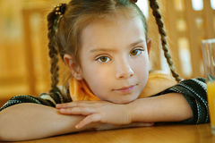Girl-preschooler sitting at table Stock Photography